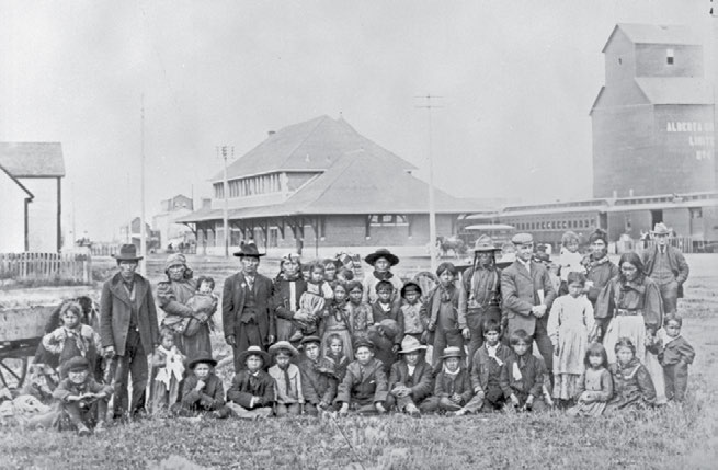 16 Truth & Reconciliation Commission A group of students and parents from the Saddle Lake Reserve, en route to the Methodist-operated Red Deer, Alberta, school. Woodruff.