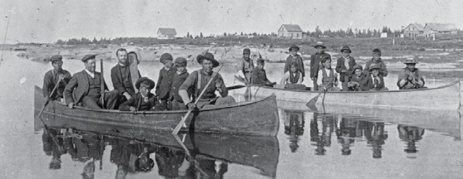22 Truth & Reconciliation Commission Reverend Thompson Ferrier taking boys to school in Brandon, Manitoba, in 1904.