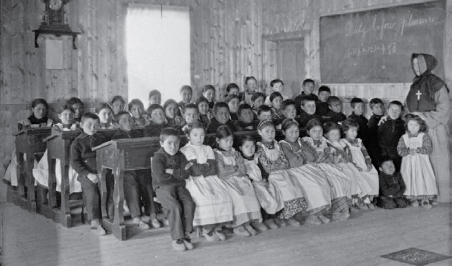 26 Truth & Reconciliation Commission Sister McQuillan and students at the Fort Resolution, Northwest Territories, school in 1923. Hudson s Bay Company Archives, Archives of Manitoba, 1987/363-I- 47.