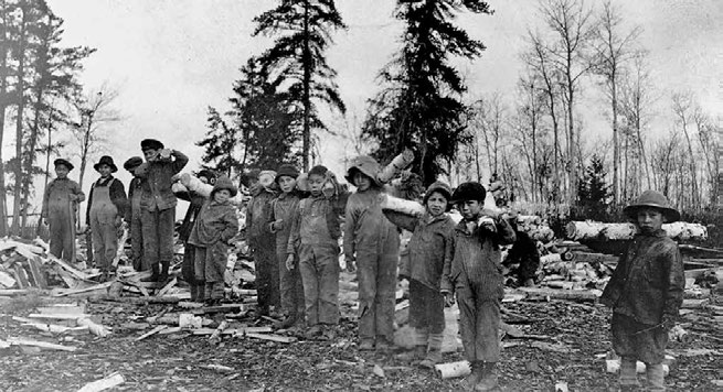 School Days: The Residential School Experience 35 Students at All Saints School in Lac la Ronge, Saskatchewan, carrying wood in the 1920s.