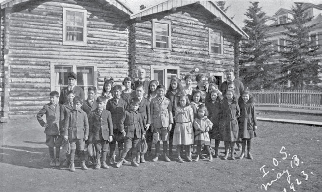 The Experience of the Métis and Residential Schools 67 Students with Bishop Isaac Stringer in front of St. Paul s Hostel in Dawson, Yukon, 1923. Most of the students living at the hostel were Métis.