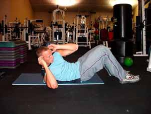 Alternating ab crunches Lie flat on your back with your feet flat on the floor and your knees bent at about 90.