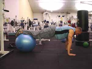 Stability ball hip flexion (knee tucks) Start with your arms in a push-up position and