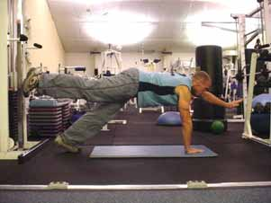 Opposite raise from push-up position Assume a push-up position on your hands and feet. Raise your right arm and left leg out simultaneously and hold for three seconds.