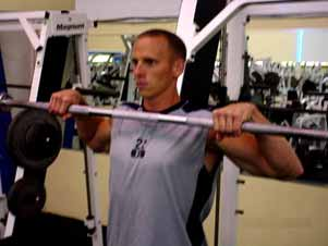 You do not flip the bar over and catch it at the shoulders as with the clean & press; you just bring the bar up explosively to below the chin and back down to your thighs, THEN lower the weight to