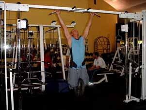 Pronated grip pull-ups Take a slightly wider than shoulder width grip and perform pull-ups from a full dead hang position