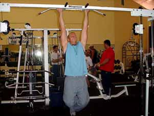 If you can complete the prescribed number of reps in a given training program easily, then you need to progress by hanging
