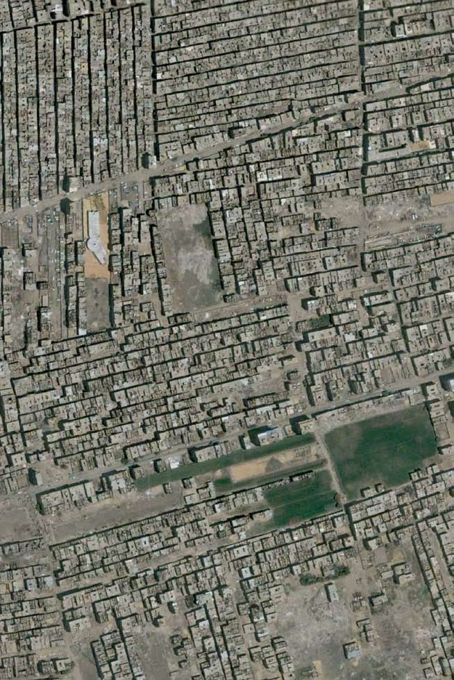 About Cairo and its Informal Areas Satellite image of informal settlements on agricutural land.