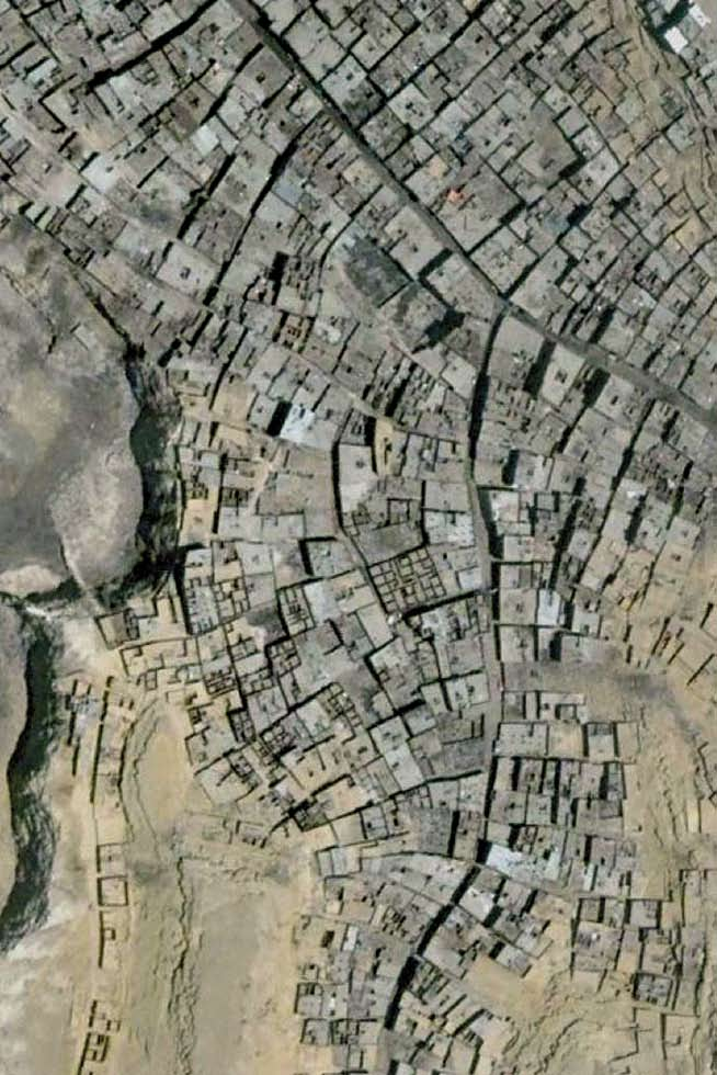 About Cairo and its Informal Areas Beyond Rules and Regulations: The Growth of Informal Cairo Satellite image of informal settlements on desert land.