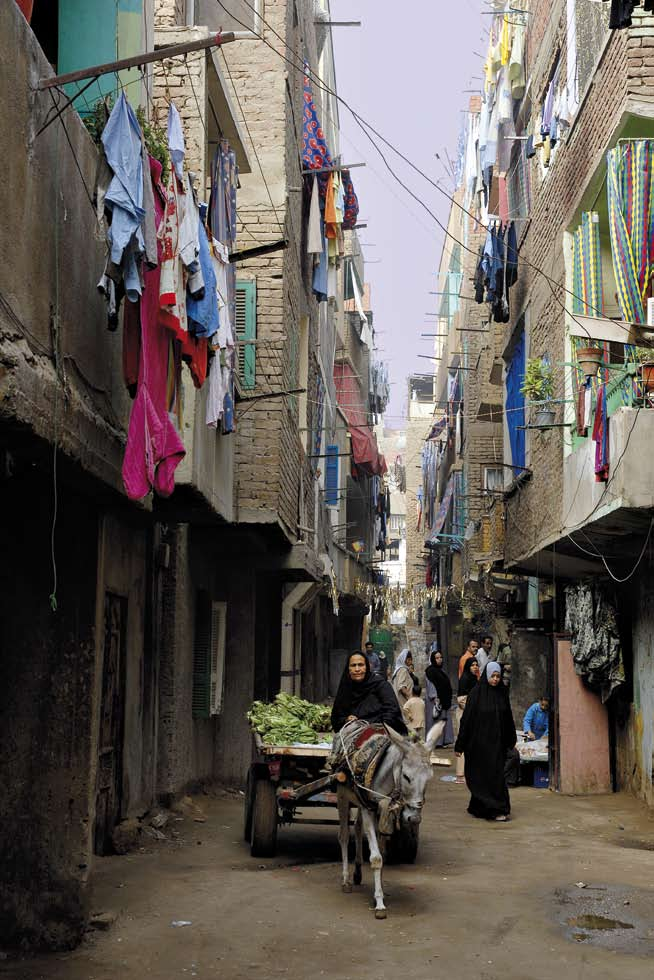About Cairo and its Informal Areas Narrow street in Boulaq al-dakrour. Advantages of Living in Informal Areas by DINA K.