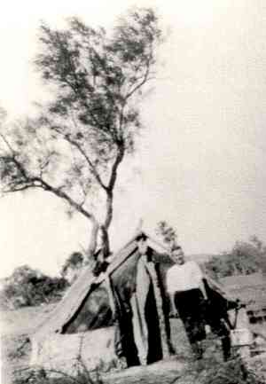4 Photo 2. Jack Tilus in 1930 on the Mt. Isa river bank. During the 1930s a few families began to arrive. By 1940 over 40 men were employed by MIM (Mount Isa Mines Pty Ltd).