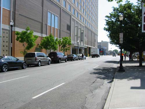 The on-street parking north of Muhammad Ali is not heavily utilized, and it is assumed that it could be eliminated to accommodate additional travel lanes.