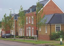 Many standard house designs do not include windows in the sides of end terraces, reducing surveillance and encouraging