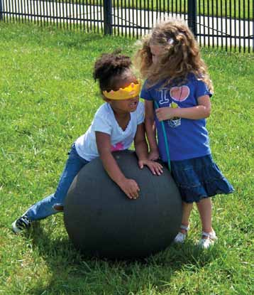 Also provide a variety of large items inclined hollow blocks, large rubber balls, sturdy tubes, exercise mats so infants can roll on, around, over, and on top of these items.