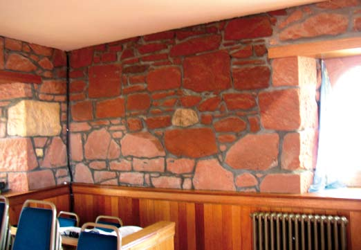A masonry wall saturated from leaking element above. Moisture build up Related to dampness emerges within a building, staining is likely to appear on plastered internal walls.