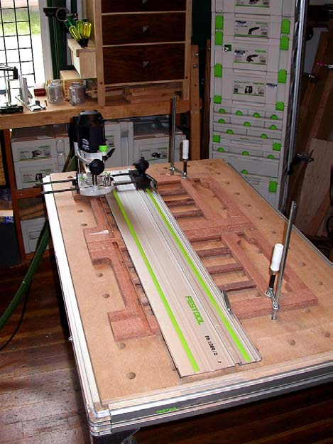 To prevent the router from falling into this cut out, save the cut out pieces and position them as shown to give a good surface for the router stabilizing foot to slide across.