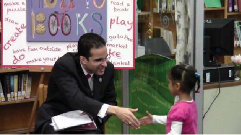 16 M. Krechevsky et al. FIGURE 5. Mayor Taveras and Leah shake hands at the library. (color figure available online.