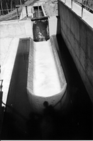 Chapter 5. Hydraulic structures 109 The commonest type of spillway is the overflow gravity type (photo 5.6). Basically it is an open channel with a steep slope and with a rounded crest at its entry.