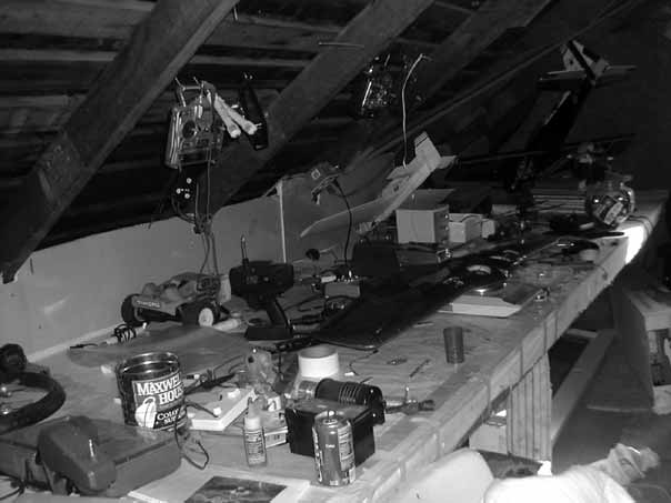 318 Mizuko Ito Figure 7.2 Attic workbench where Zelan and his dad tinker with remote control aircraft and other electronics. Photo by Christo Sims, 2006.