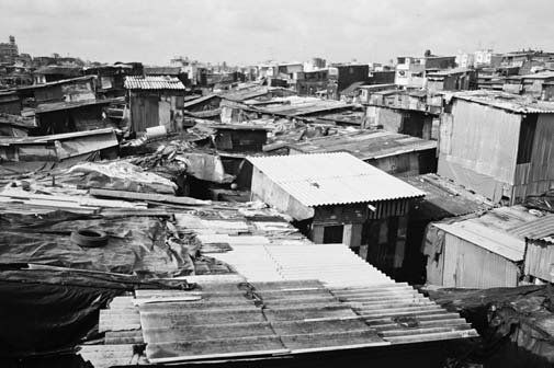 Dharavi is Asia s largest slum, with more than 70,000 slum dwellings occupying about 0.671 square miles of land. Image courtesy Times of India, Times News Network, Jan. 22, 2004.