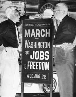 1963 Bayard Rustin (left) and Cleveland Robinson in front of March on Washington headquarters.