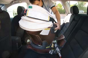 Check both Rotation Indicators on the Base. If either Rotation Indicator is red, the Infant Car Seat is not safely locked.