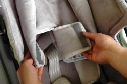position. 1. The Infant Insert has two slots to allow the Restraint Harness shoulder straps to pass through.