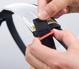 Insert the hook and loop fastener through the D-ring on the Soft Carrier Handle Grip. Secure in place (Photo B). 3.