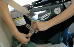 While pressing down upon the Infant Car Seat, pull on the shoulder-lap belt to tighten it around the child