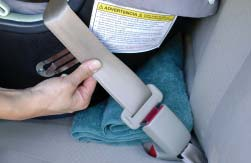 To mark their position, hold the shoulder and lap straps together near the Belt Clip (Photo D) and unbuckle
