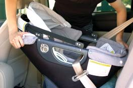 While holding the two vehicle seat belt straps together, slip them together into the Belt Clip. (Photo E).
