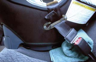 While pressing down upon the Infant Car Seat, pull on the extender strap (if available) to tighten the lap-only belt on the Infant Car