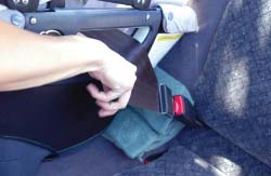 While holding the strap in place, slip both portions together into the Belt Clip. (Photo K).