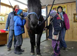 2 Touching Base, Summer 2014 horse therapy program A Final Visit With Their Therapeutic Equine Friends The Wonderful world of horse therapy On a chilly February day, the Hampstead Daycare students in