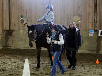 After a quick warm up jog around the arena to get their energy out, two at a time, the children demonstrated their first new-learned skill by grooming one of the calm ponies using various brushes and