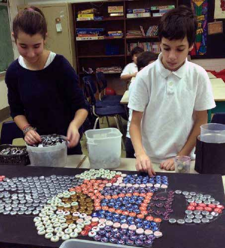 The John Caboto Academy Grade 4, 5, and 6 daycare students began a project using recycled beer bottle caps to build large pieces of art.