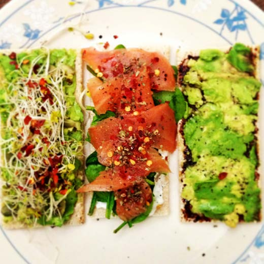 (CENTER) Spread a layer of smashed avocado, top with steamed baby spinach and smoked salmon slices. Grind over salt and pepper, and sprinkle some chilli flakes. Drizzle with lemon juice!