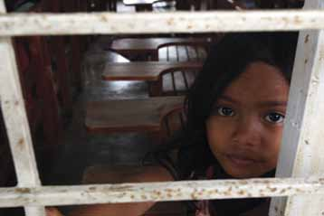 111 East Asia and the Pacific A girl inside her school in the city of Cagayan de Oro in Northern Mindanao Region of the Philippines. The school was damaged by floods.