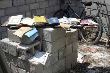 41 The Maldives Islands - Some school books spared by the tsunami (26 December 2004) are slowly sun-drying. UNESCO/ Hameed A.
