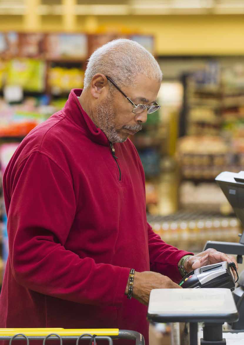 Customer at a grocery store checkout Getty Images Global