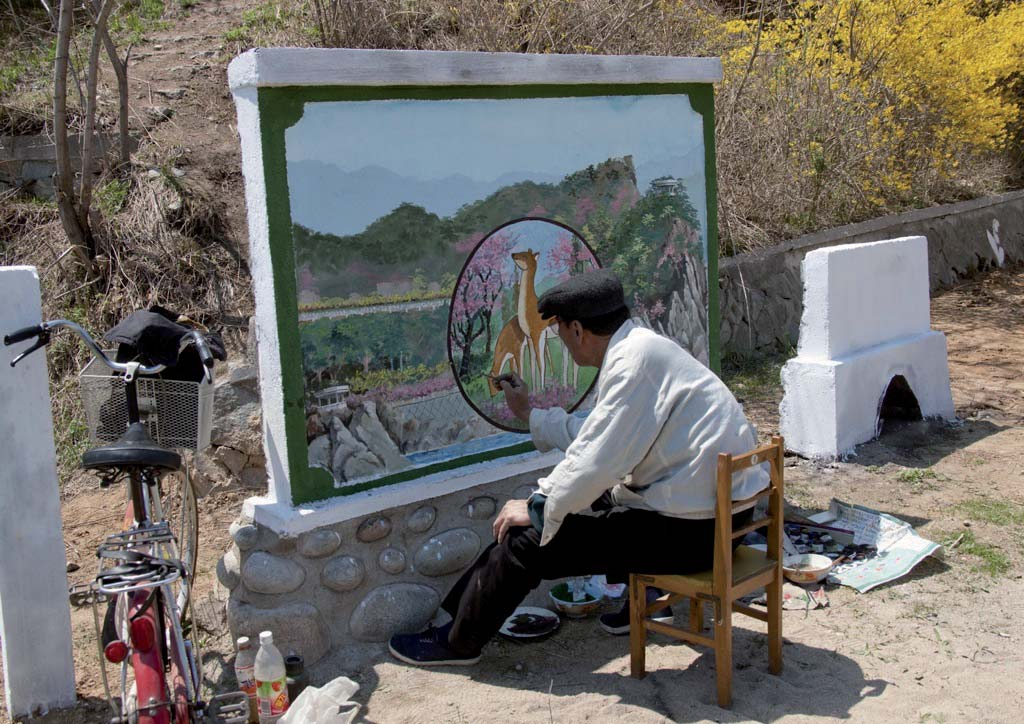 Perhaps the most ridiculous prohibition I faced: this official painter was working on a new mural in Chilbo.