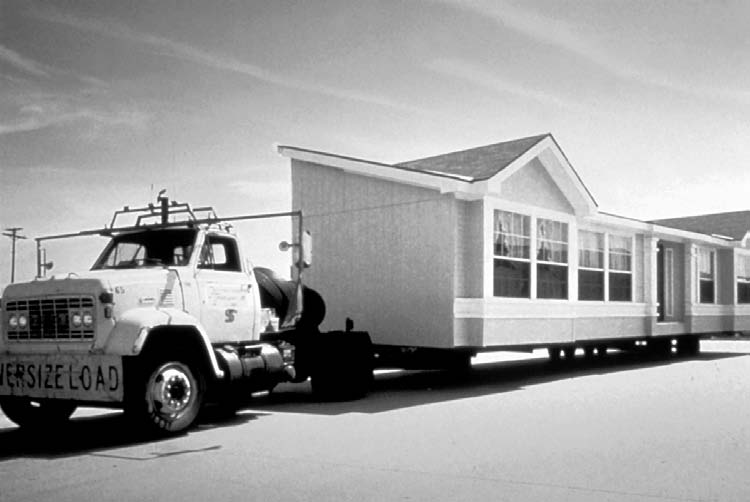 MANUFACTURED HOMES 2 Figure 2-4. One section of a double-section manufactured home being transported. Source: Manufactured Housing Institute.