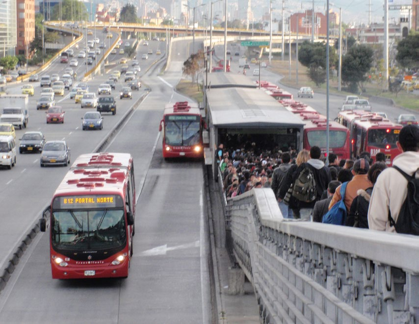 TransMilenio s passing lanes at stations have increased the capacity of the system threefold.