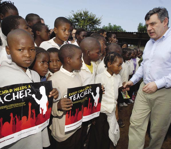 2 4 Pupils at Forces Primary School urge Gordon Brown, British Chancellor of the Exchequer, to support the