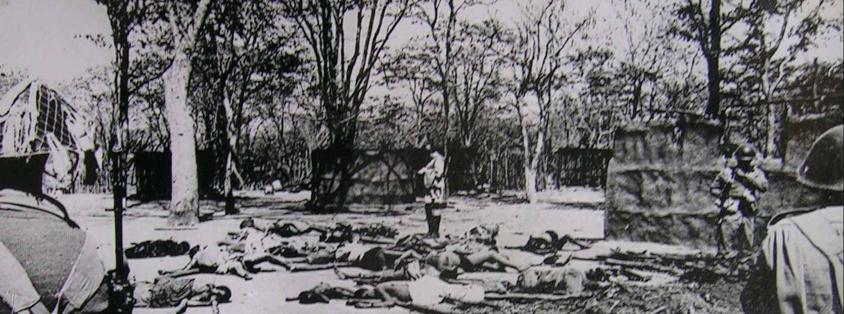 62 GORDON and destroy their settlement. They killed a second European policeman, Inspector Jordan. 61 Photo 4 Zambian soldiers survey the dead followers of Alice Lenshina, Chinsali District, 1964.