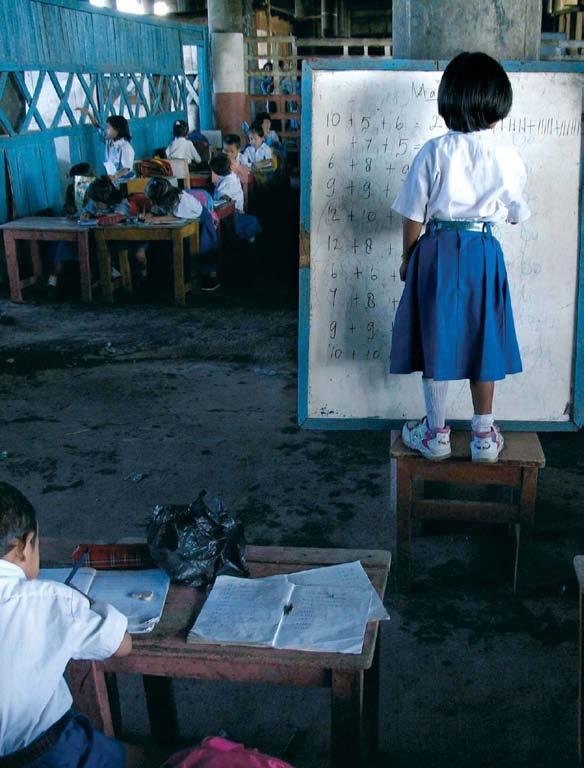 Education for All Global Monitoring Report 2 8 Under her teacher s eye, a