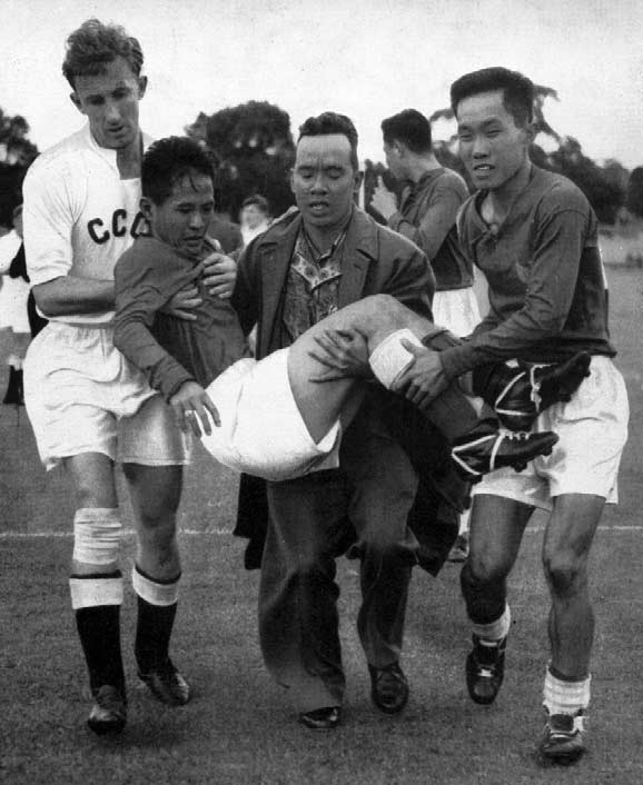 Indonesia's left half, L. H. Tan, had to be carried off the field during the second round goal-less draw between Indonesia and India d.