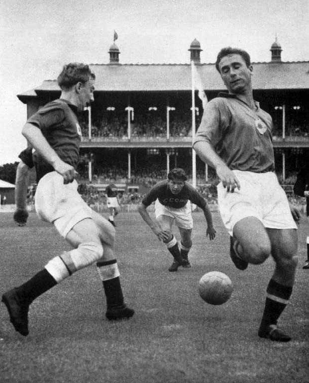 Russian left half, Netto, (left) and Yugoslavia right wing, Mujic, duel for the ball during the final. Main Stadium, 8th December (Half-time score : 0 0) : Iachine, L. ; Bachachkine, A.