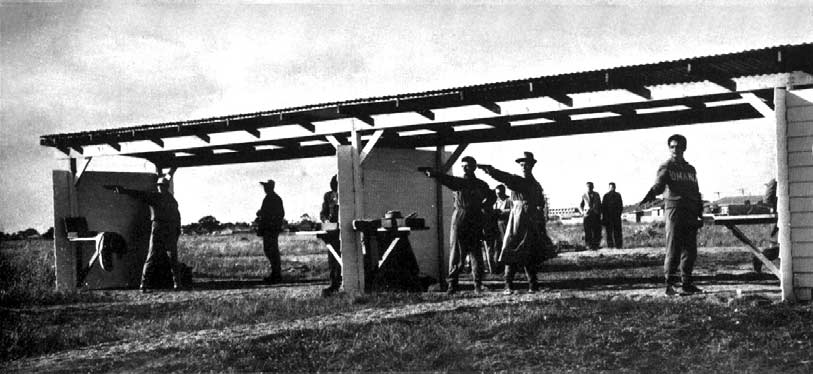 "The Rumanian Team practising on the silhouette range before dividing partitions were placed in stations. The practice group was on "" J "" group between the free rifle and the running deer ranges."