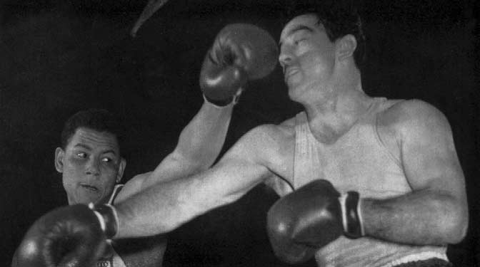Papp (right) defeated Torres in the Lightmiddleweight final and gained his third successive Olympiad Gold Medal. LIGHT MIDDLEWEIGHT (Up to 7 kg. 6 lb. 8 oz. 7 dr.) Previous Olympic Winner 9 L. Papp.